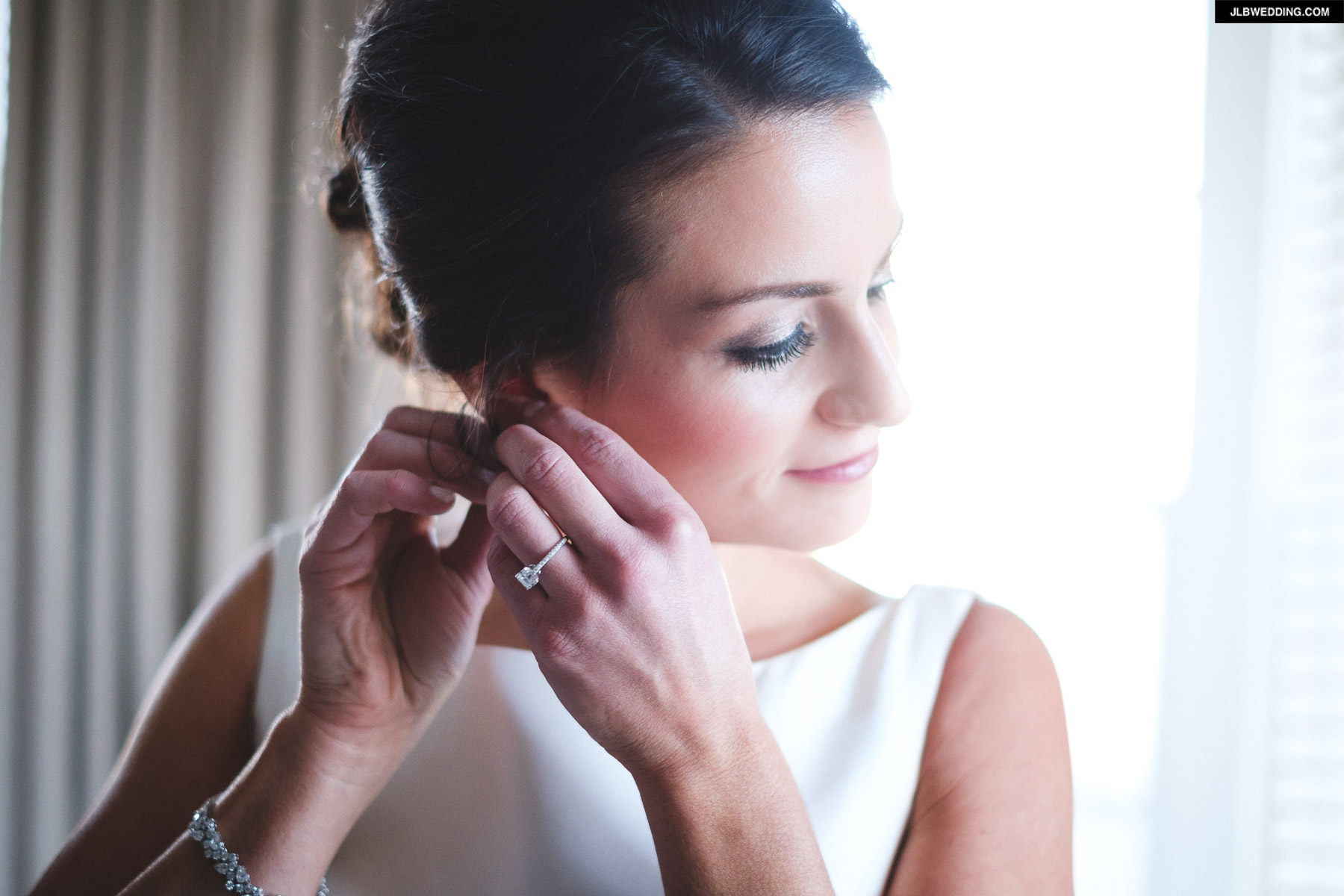 Sarah putting on earring